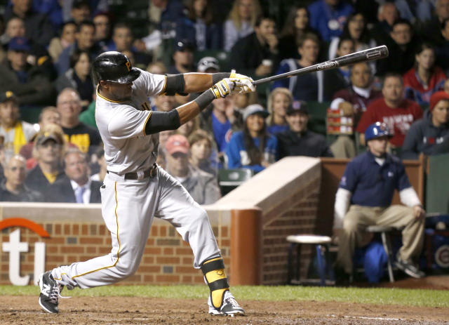 Pittsburgh Pirates' Starling Marte hits a home run off Chicago Cubs relief pitcher Kevin Gregg during the ninth inning of a baseball game Monday, Sept. 23, 2013, in Chicago. The home run gave the Pirates a 2-1 lead. (AP Photo/Charles Rex Arbogast)