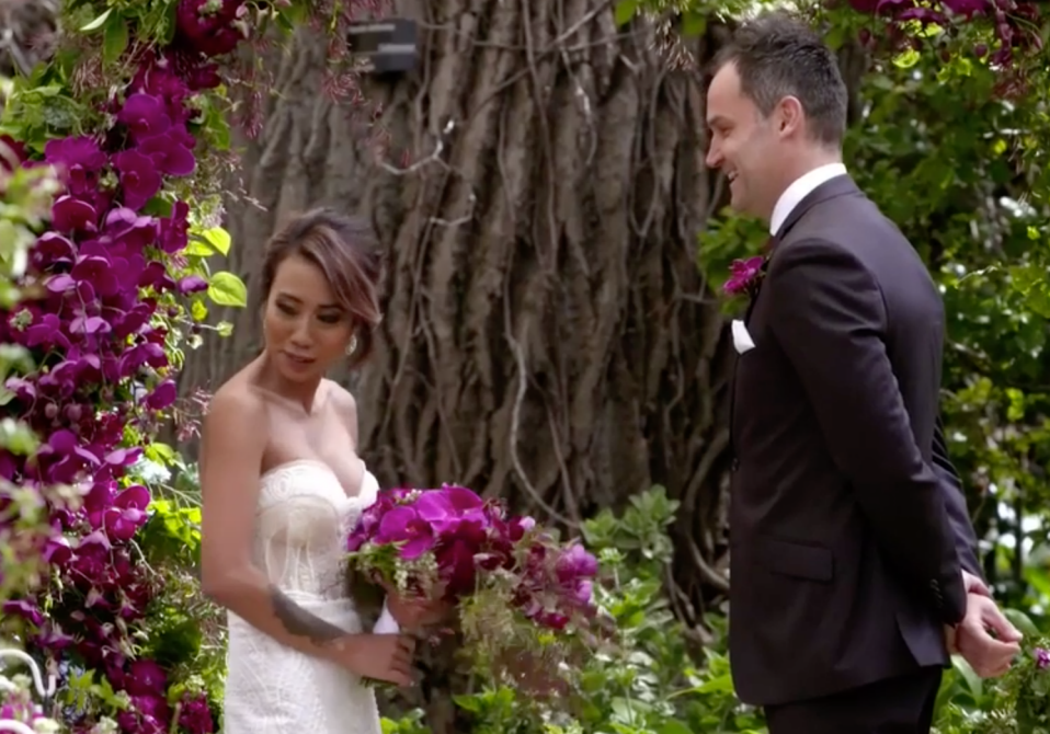 Married At First Sight 2019 contestants Ning Surasiang and Mark Scrivens standing at the altar on their wedding day