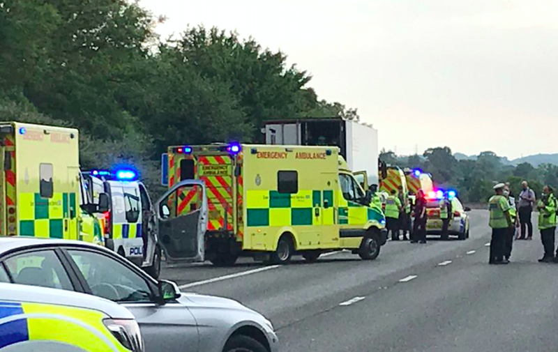 Police on the M11 motorway after sixteen people were arrested for immigration offences. (Andy Brookes/Twitter/PA)