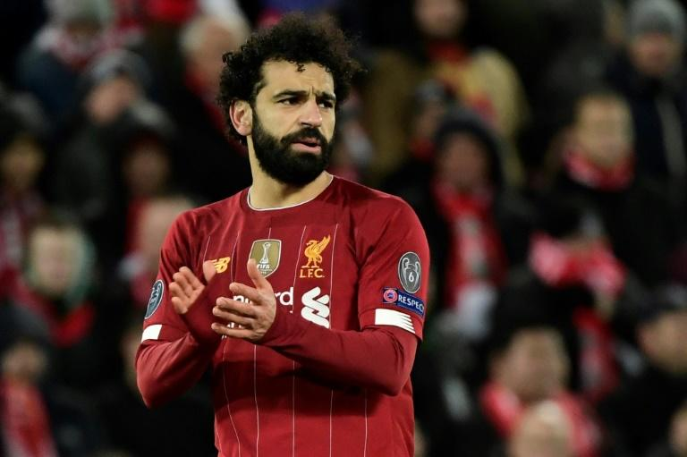 Mohamed Salah starts on the bench for Liverpool's trip to Everton on Sunday