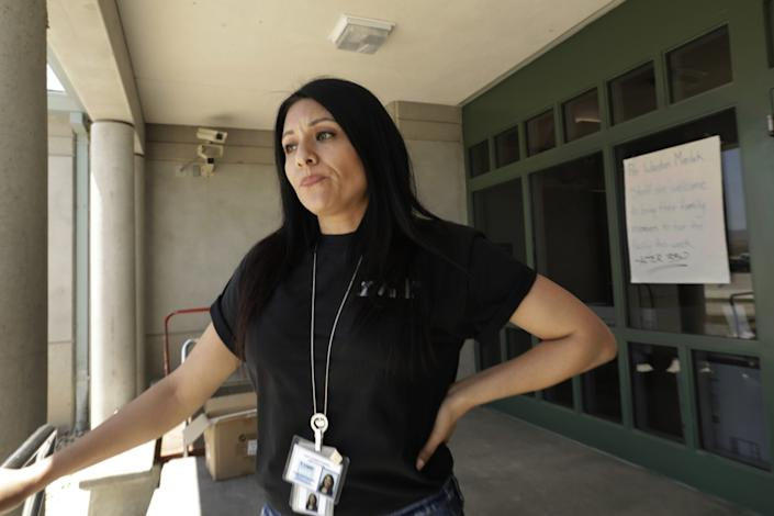 """""""I've been here for 18 years,"""" she said, """"I didn't see this coming,"""" said Yeni Lopez, a quality control specialist at the prison. The recent closing of the privately owned federal prison in Taft has was another setback for the town. <span class=""""copyright"""">(Carolyn Cole/Los Angeles Times)</span>"""