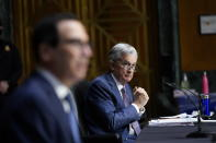Chairman of the Federal Reserve Jerome Powell and Treasury Secretary Steven Mnuchin testify during a Senate Banking Committee hearing on 'The Quarterly CARES Act Report to Congress' on Capitol Hill in Washington, Tuesday, Dec. 1, 2020. (AP Photo/Susan Walsh, Pool)