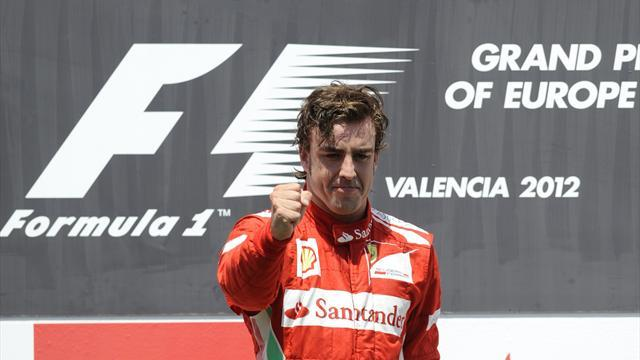 Ferrari's Spanish driver Fernando Alonso celebrates on the podium at the Valencia Street Circuit on June 24, 2012 in Valencia after the European Formula One Grand Prix (AFP)