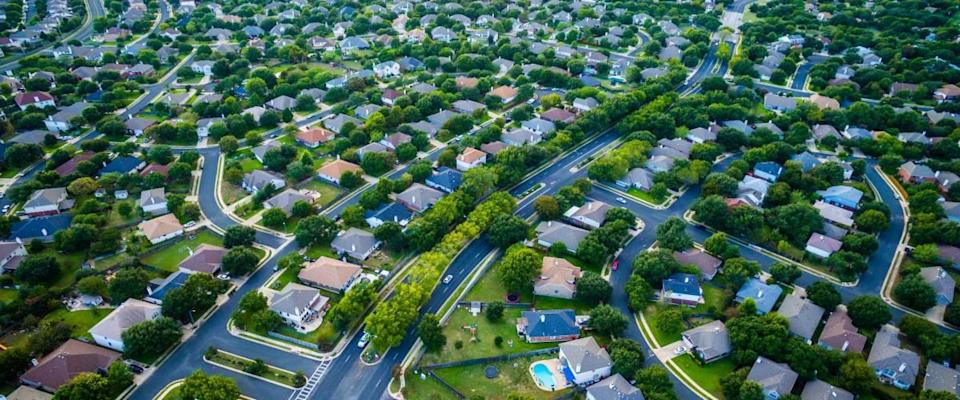 Thousands of homes aerial bird's eye view of suburban housing development new neighborhood in Austin, Texas, USA modern architecture and design