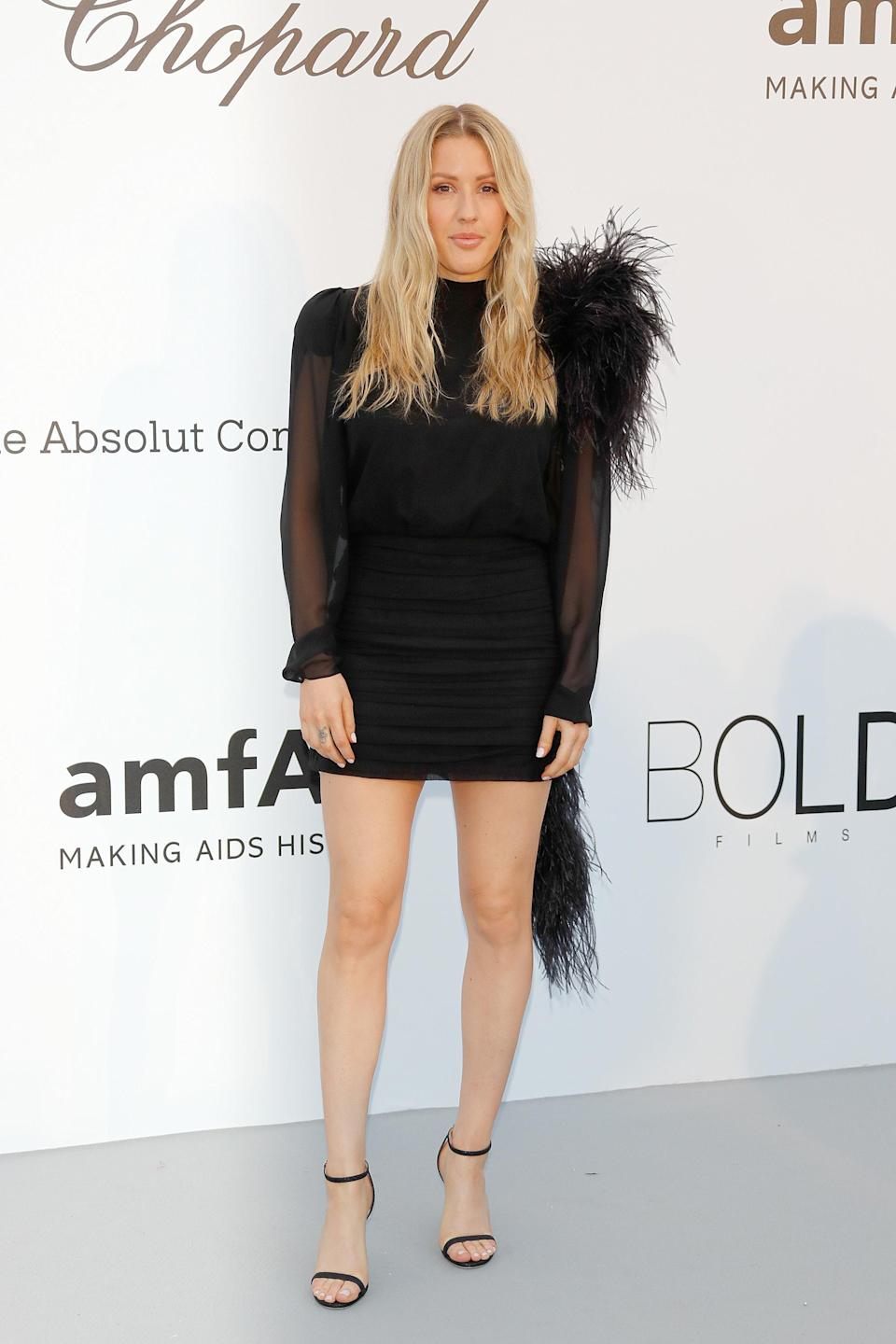 <p>Ellie Goulding trialled the sheer trend in a feathered mini dress. [Photo: Getty] </p>