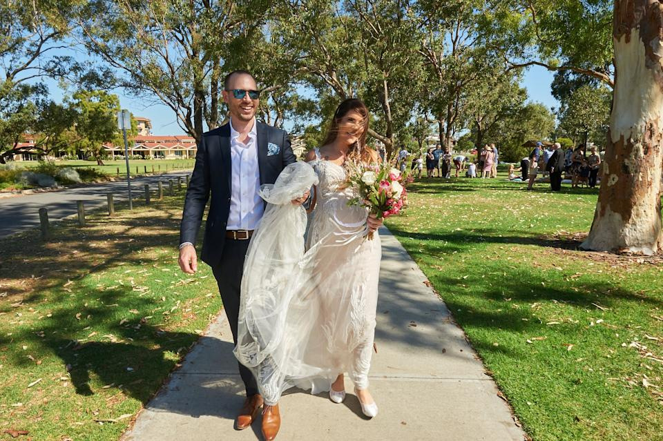 Tracey Jewel and husband walk to park after wedding