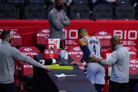 Washington Wizards' Russell Westbrook (4) is helped to the locker room after an injury during the second half of Game 2 in a first-round NBA basketball playoff series against the Philadelphia 76ers, Wednesday, May 26, 2021, in Philadelphia. (AP Photo/Matt Slocum)