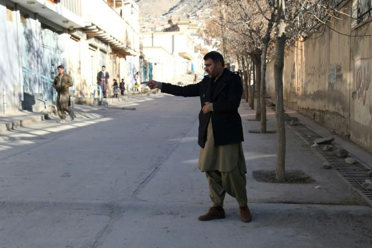 Abdul Baqi Rasheed points to the spot where his brother, the activist Mohammad Yousuf Rasheed, was shot dead in Kabul