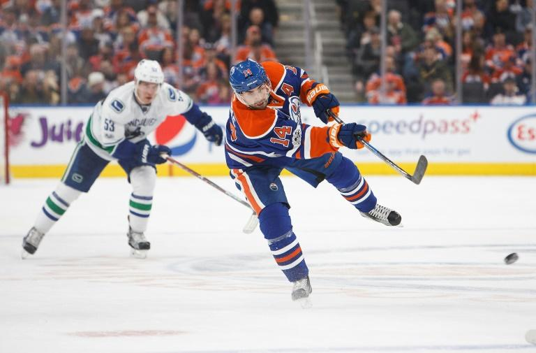 Jordan Eberle of the Edmonton Oilers takes a shot against the Vancouver Canucks, at Rogers Place in Edmonton, Alberta, on April 9, 2017