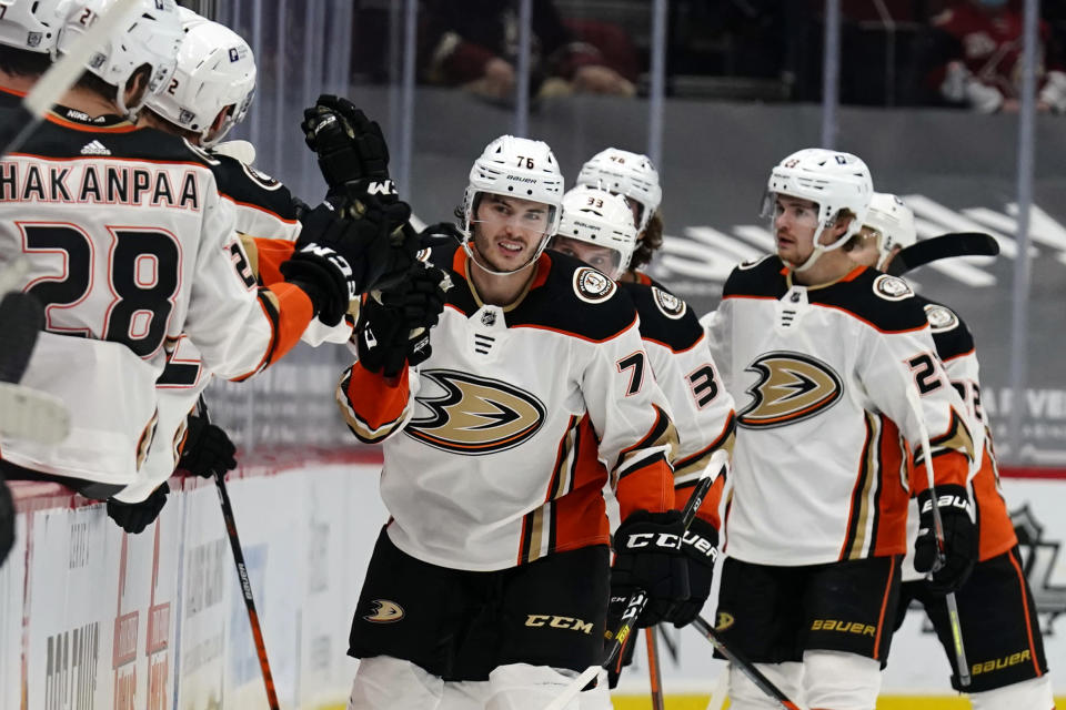 Anaheim Ducks defenseman Josh Mahura (76) celebrates with teammates after scoring a goal against the Arizona Coyotes during the second period of an NHL hockey game Wednesday, Feb. 24, 2021, in Glendale, Ariz. (AP Photo/Rick Scuteri)