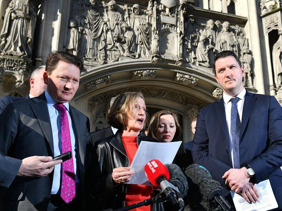 Geraldine Finucane, the widow of murdered Belfast solicitor Pat Finucane, accompanied by her sons John (right) and Michael (left) speaks with reporters outside the Supreme Court in central London, after the family lost a Supreme Court challenge over the decision not to hold a public inquiry into his killing, but won a declaration that an effective investigation into his death has not been carried out (Dominic Lipinksi/PA)