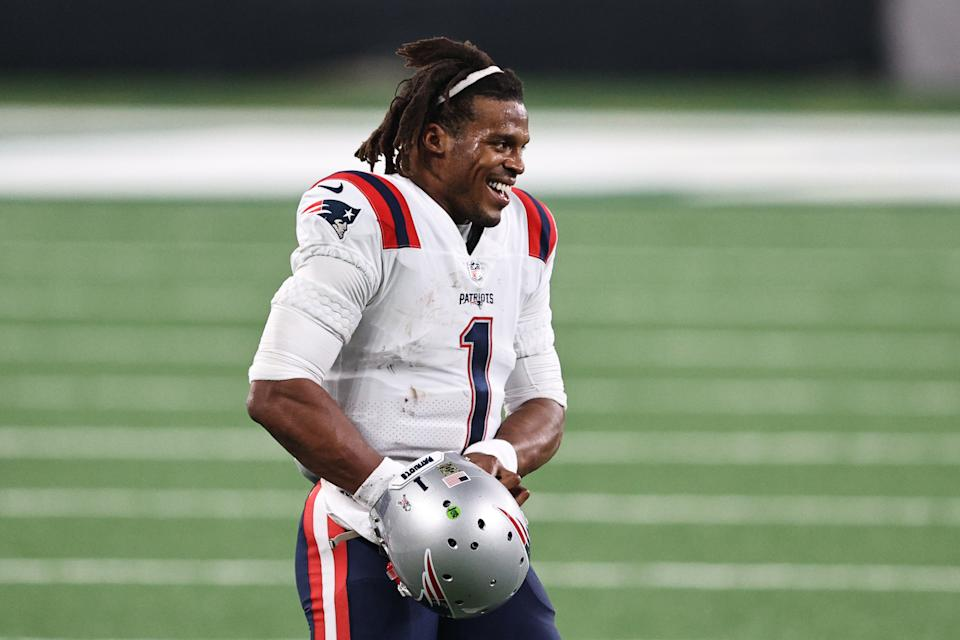 EAST RUTHERFORD, NEW JERSEY - NOVEMBER 09: Cam Newton #1 of the New England Patriots smiles as he heads on to the field during the second half against the New York Jets at MetLife Stadium on November 09, 2020 in East Rutherford, New Jersey. (Photo by Elsa/Getty Images)