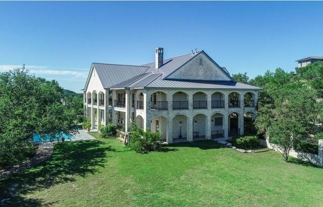 """The 2.6-acre estate has a 9,600-square-foot home, a grassy yard with a pool and a 600-square-foot stone wine cellar. <span class=""""copyright"""">(Realtor.com)</span>"""