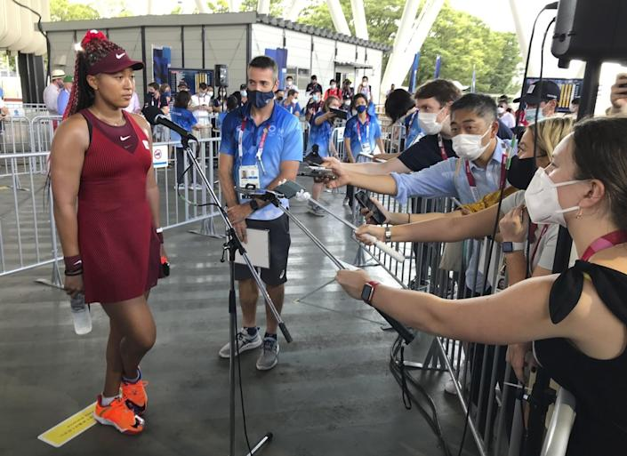 Naomi Osaka speaks with journalists after her first-round singles win.