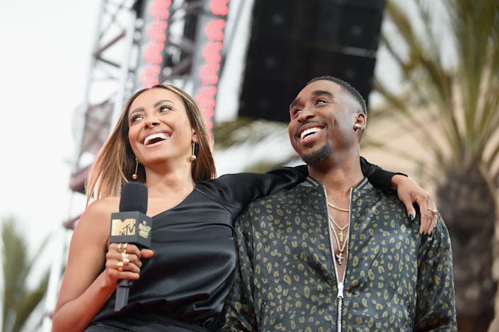 Actors Kat Graham(L) and Demetrius Shipp onstage at the 2017 MTV Movie And TV Awards at The Shrine Auditorium on May 7, 2017 in Los Angeles, California.