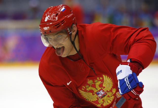Russia's Alexander Ovechkin sticks his tongue out during the team's first practice at the 2014 Sochi Winter Olympics, February 10, 2014. REUTERS/Brian Snyder (RUSSIA - Tags: OLYMPICS SPORT ICE HOCKEY)