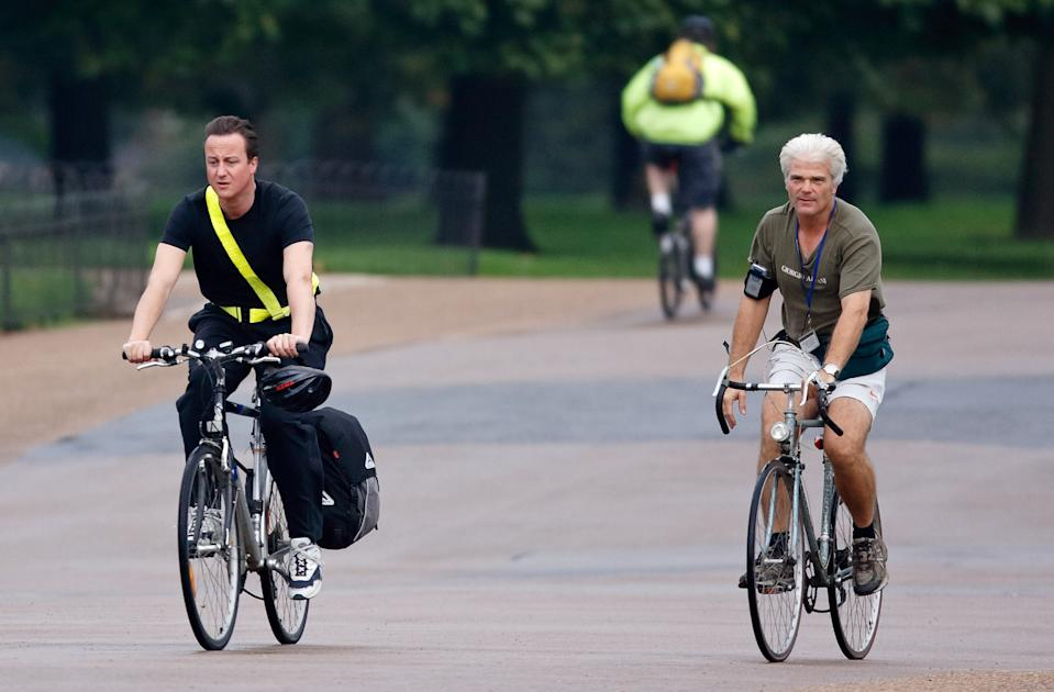 LONDON, UNITED KINGDOM - OCTOBER 11: (EMBARGOED FOR PUBLICATION IN UK NEWSPAPERS UNTIL 24 HOURS AFTER CREATE DATE AND TIME) Leader of the Conservative Party David Cameron and Desmond Swayne (Parliamentary Private Secretary to David Cameron) seen cycling through Hyde Park on October 11, 2006 in London, England. (Photo by Max Mumby/Indigo/Getty Images)