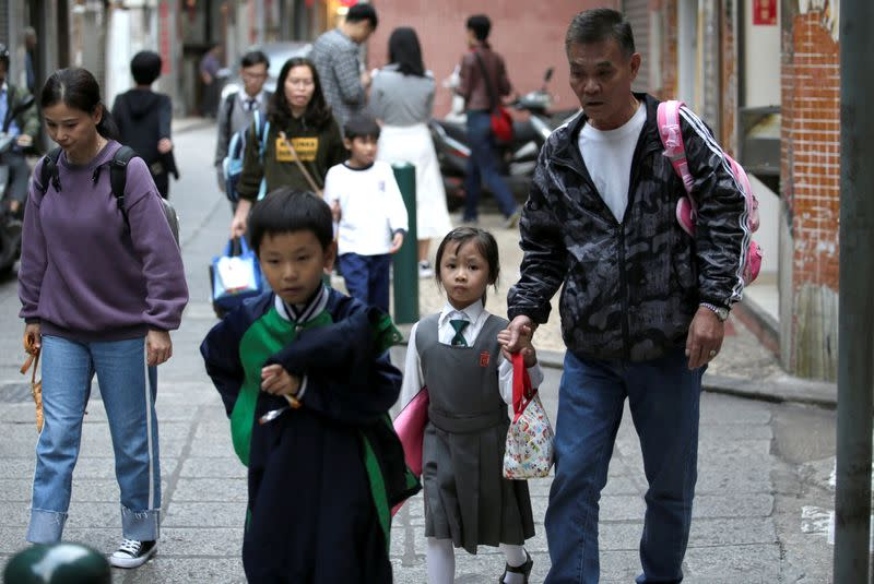 Pupils come back from school, in Macau