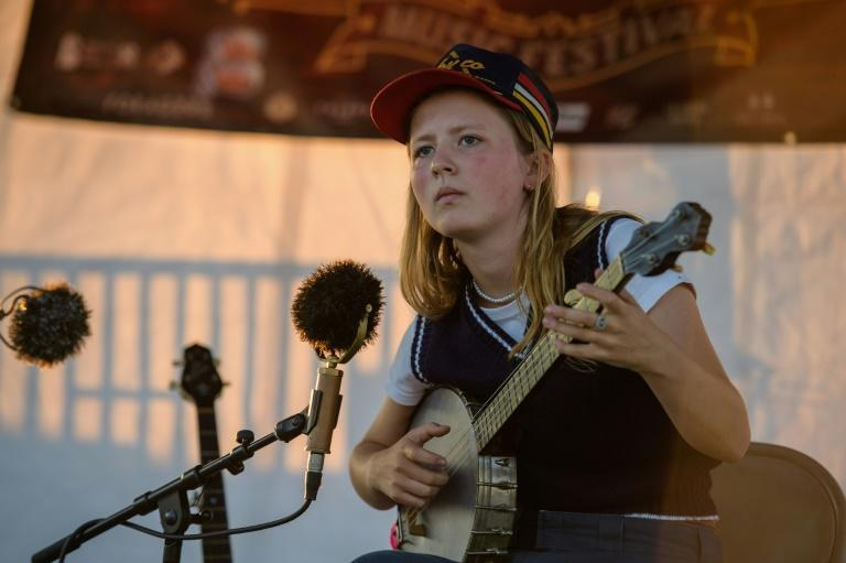 At an age when most teenagers are busy learning the latest Tik Tok dance craze, banjo virtuoso Nora Brown has just released her second album of old-time twang (AFP/Angela Weiss)
