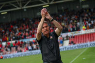 """In this photo provided by Wrexham FC, Wrexham manager Phil Parkinson applauds the fans at Racecourse Ground in Wrexham, Wales, Saturday, Sept. 18, 2021. It has been described as a """"crash course in football club ownership"""" and the two Hollywood stars who bought a beleaguered team in English soccer's fifth tier with the lofty aim of transforming it into a global force are certainly learning on the job. (Gemma Thomas/Wrexham FC via AP)"""
