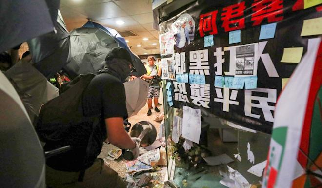 Protesters smashing Junius Ho's Tsuen Wan office. The pro-Beijing lawmaker has become a hate figure for the movement. Photo: Sam Tsang
