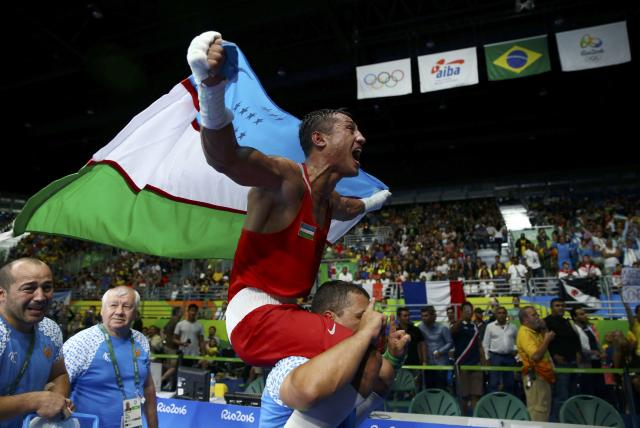 2016 Rio Olympics - Boxing - Final - Men's Light Welter (64kg) Final Bout 272 - Riocentro - Pavilion 6 - Rio de Janeiro, Brazil - 21/08/2016. Fazliddin Gaibnazarov (UZB) of Uzbekistan celebrates after winning his bout. REUTERS/Peter Cziborra FOR EDITORIAL USE ONLY. NOT FOR SALE FOR MARKETING OR ADVERTISING CAMPAIGNS.