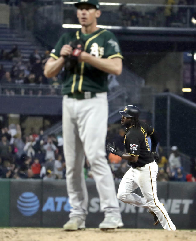 Pittsburgh Pirates' Josh Bell, right, rounds the bases after hitting a two-run home run off starting pitcher Chris Bassitt during the third inning of a baseball game in Pittsburgh, Saturday, May 4, 2019. It was Bell's second home run of the game. (AP Photo/Gene J. Puskar)