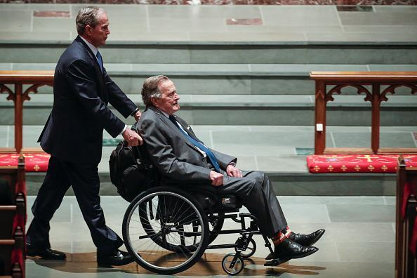 Former president George W. Bush, left, wheels his father, former president George H.W. Bush into the church for the funeral for former first lady Barbara Bush at St. Martin's Episcopal Church on April 21, 2018 in Houston, Texas. Bush, wife of former president George H. W. Bush and mother of former president George W. Bush, died on April 17 at the age of 92. (Photo by Brett Coomer – Pool/Getty Images)
