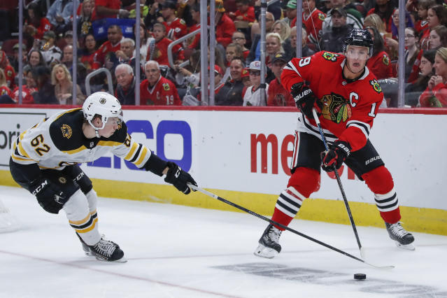Boston Bruins center Oskar Steen, left, defends against Chicago Blackhawks center Jonathan Toews, right, during the second period of a preseason NHL hockey game Saturday, Sept. 21, 2019, in Chicago. (AP Photo/Kamil Krzaczynski)