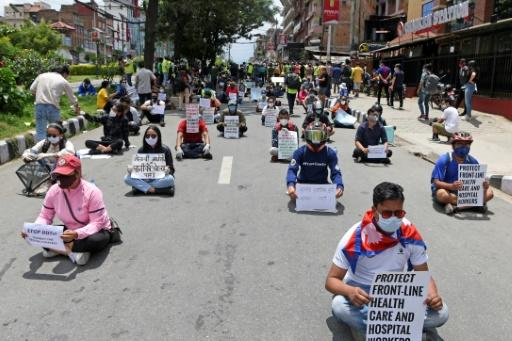 Protesters in Nepal are demanding better testing and quarantine facilities for returning migrant workers