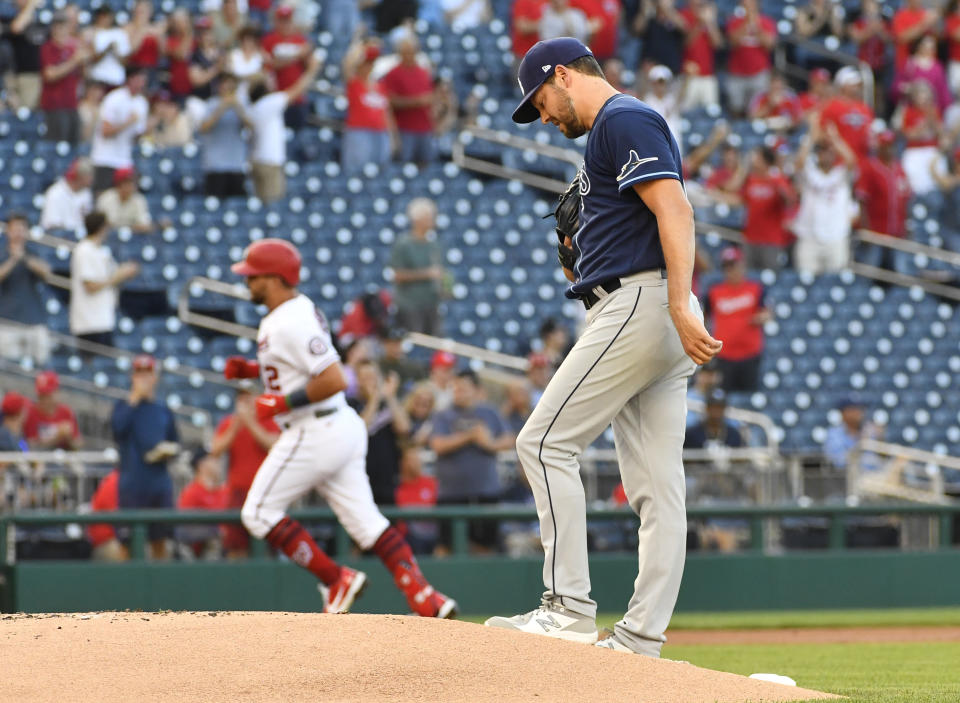 Tampa Bay Rays starting pitcher Rich Hill (14) reacts after giving up a home run to Washington Nationals left fielder Kyle Schwarber (12) during the first inning at Nationals Park. Mandatory Credit: Brad Mills-USA TODAY Sports