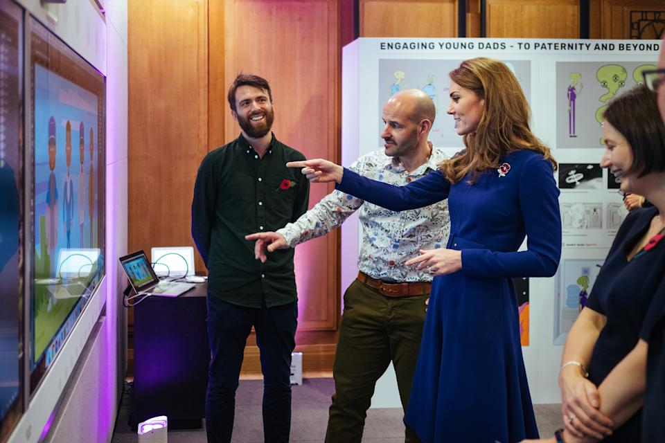 EMBARGOED TO 2230 MONDAY JULY 13 Undated handout photo issued by Kensington Palace of the Duchess of Cambridge reviewing a new BBC education resource called Tiny Happy People.