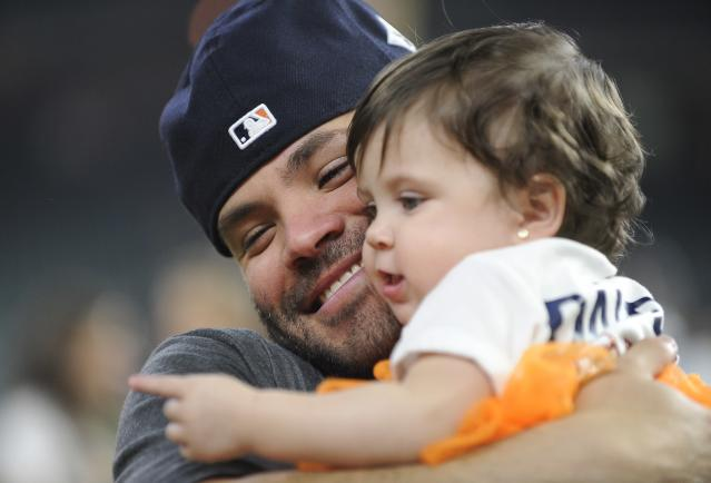 Houston Astros' Jose Altuve celebrates with his daughter Melanie after Game 7 of baseball's American League Championship Series against the New York Yankees Saturday, Oct. 21, 2017, in Houston. The Astros won 4-0 to win the series. (AP)
