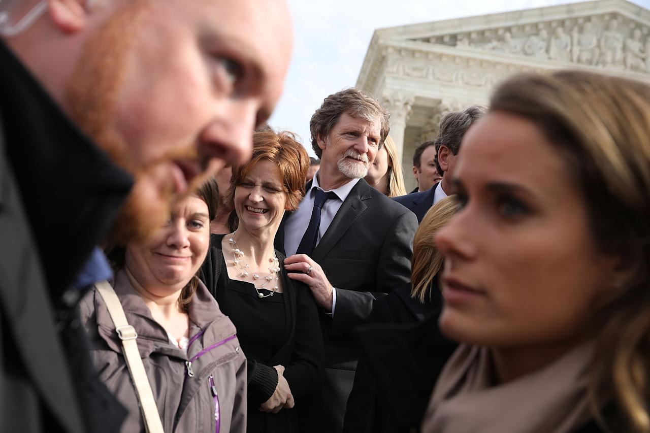 <p>Conservative Christian baker Jack Phillips (C), his daughter Lisa (3rd L) and other members of his family and legal team pose for photographs in front of the Supreme Court after the court heard the case Masterpiece Cakeshop v. Colorado Civil Rights Commission on Dec. 5, 2017 in Washington. (Photo: Chip Somodevilla/Getty Images) </p>