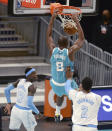 Charlotte Hornets center Bismack Biyombo, center, throws down a two-handed dunk against the Los Angeles Lakers during the first half of an NBA basketball game in Charlotte, N.C., Tuesday, April 13, 2021. (Jeff Siner/The Charlotte Observer via AP)