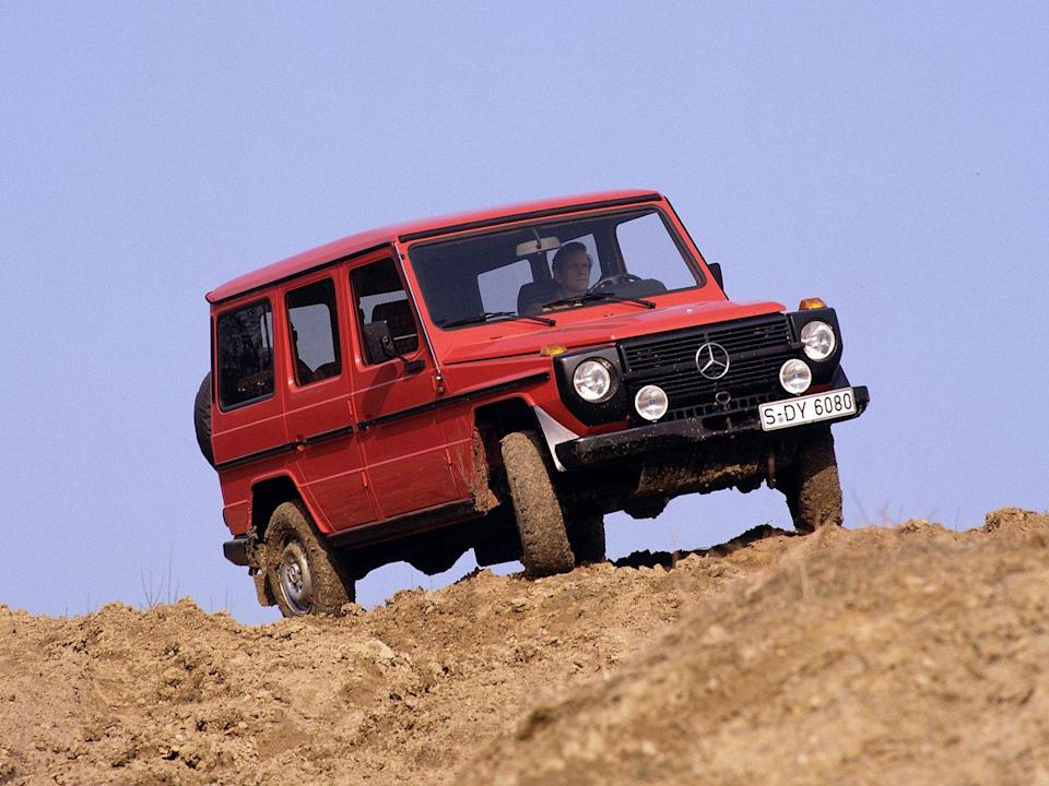 """<p>Mercedes didn't officially sell its G-wagen in the United States until 2002, but gray-market importers kinda-sorta-legally started bringing them across the pond two decades prior. In the '80s, the G-wagen wasn't yet <a href=""""https://www.caranddriver.com/news/a15341359/the-history-of-the-mercedes-benz-g-wagen-how-a-farm-implement-became-a-status-symbol/"""" rel=""""nofollow noopener"""" target=""""_blank"""" data-ylk=""""slk:the status symbol it is today"""" class=""""link rapid-noclick-resp"""">the status symbol it is today</a>; <a href=""""https://www.caranddriver.com/features/g15896598/from-brute-to-bourgeois-a-brief-visual-history-of-mercedes-benzs-g-wagen-suv/"""" rel=""""nofollow noopener"""" target=""""_blank"""" data-ylk=""""slk:based on a late-'70s military truck"""" class=""""link rapid-noclick-resp"""">based on a late-'70s military truck</a>, the Benz was fairly stripped down, which is what gave the original its appeal. In America, the truck quickly gained a cult following in certain markets, including New England and California. Of course, as soon as Americans fell in love, the G's price shot up. Today, the official models sold by Mercedes are six-figure glamour-mobiles. <em>—Daniel Golson</em></p>"""