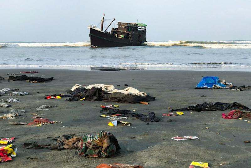 The belongings of Rohingya refugees on the shore as their boat remains anchored in Teknaf on 16 April.