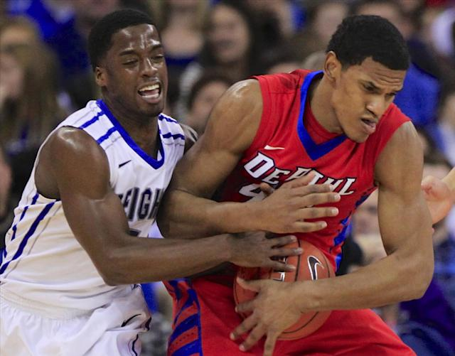 DePaul's Greg Sequele (42) and Creighton's Austin Chatman (1) struggle for the ball in the first half of an NCAA college basketball game in Omaha, Neb., Friday, Feb. 7, 2014. (AP Photo/Nati Harnik)