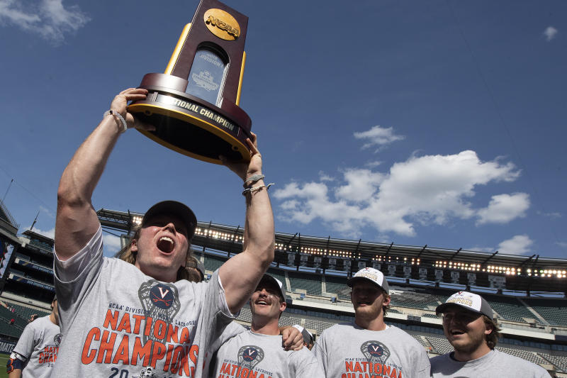 Virginia's Ryan Pride raises the trophy after defeating Yale in the NCAA college lacrosse championship in Philadelphia on Monday, May 27, 2019. Virginia beat defending champion Yale, 13-9, in the national title game Monday. (Jose F. Moreno/The Philadelphia Inquirer via AP)