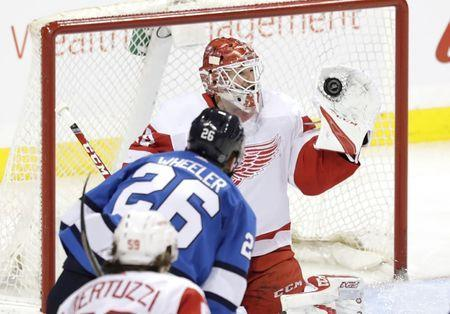 Jan 11, 2019; Winnipeg, Manitoba, CAN; Detroit Red Wings goaltender Jonathan Bernier (45) gloves a shot from Winnipeg Jets right wing Blake Wheeler (26) in the third period at Bell MTS Place. Mandatory Credit: James Carey Lauder-USA TODAY Sports