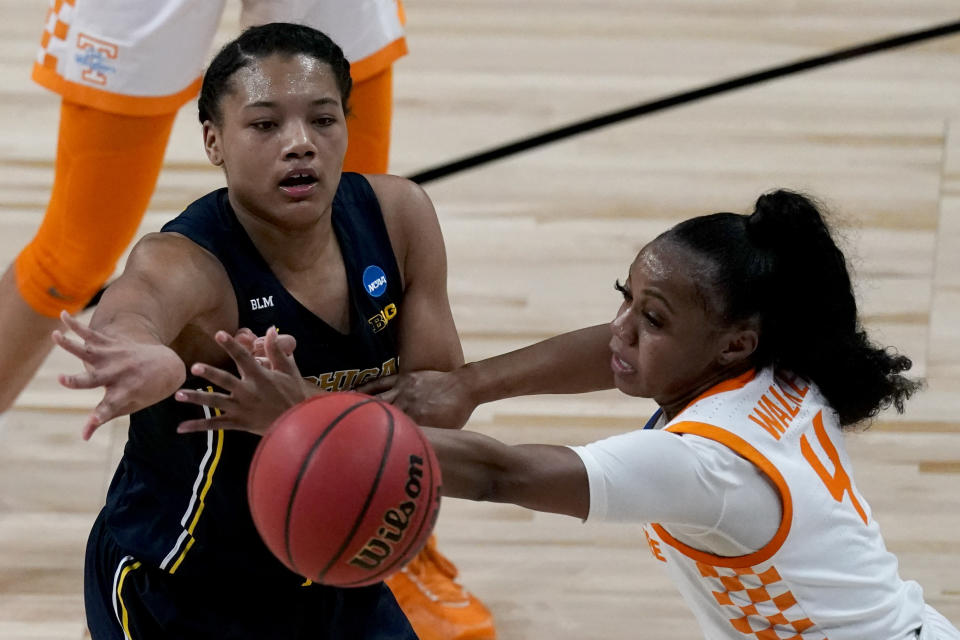 Michigan forward Naz Hillmon passes under pressure from Tennessee guard Jordan Walker during their game in the second round of the NCAA women's tournament at the Alamodome in San Antonio on March 23, 2021. Michigan won 70-55. (AP Photo/Charlie Riedel)