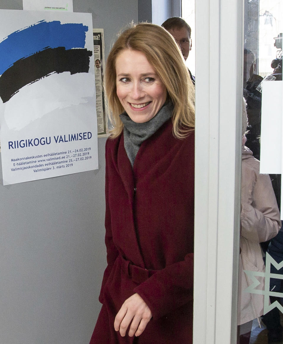 FILE - In this file photo dated Sunday, March 3, 2019, Chairwoman of the Reform Party Kaja Kallas arrives at a polling station during a parliamentary elections in Tallinn, Estonia. 43-year old Kallas has tested positive for COVID-19 and said late Monday March 15, 2021, she was feeling well apart from a small fever and hasn't developed any other symptoms, she will self-quarantine until recovered. (AP Photo/Raul Mee, FILE)