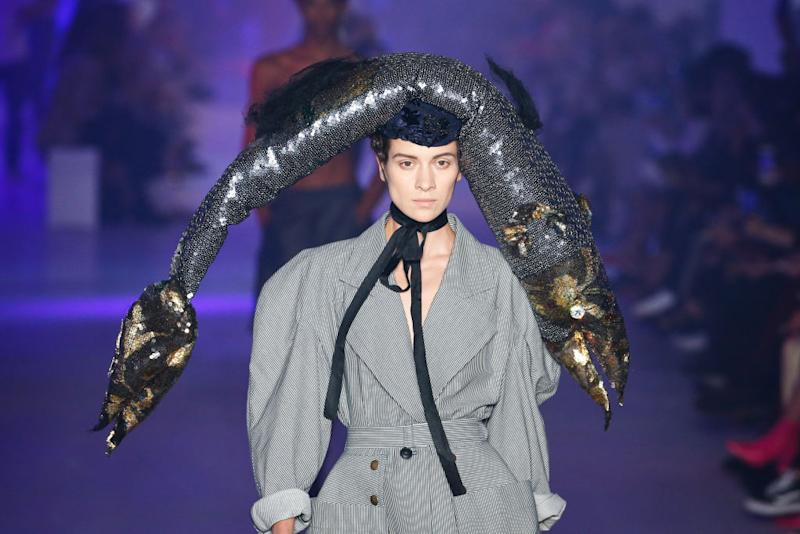 A model graced the runway in a giant fish hat at Vivienne Westwood [Photo: Getty]