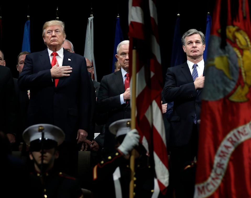 President Donald Trump, then-Attorney General Jeff Sessions, center and FBI Director Christopher Wray in 2017.