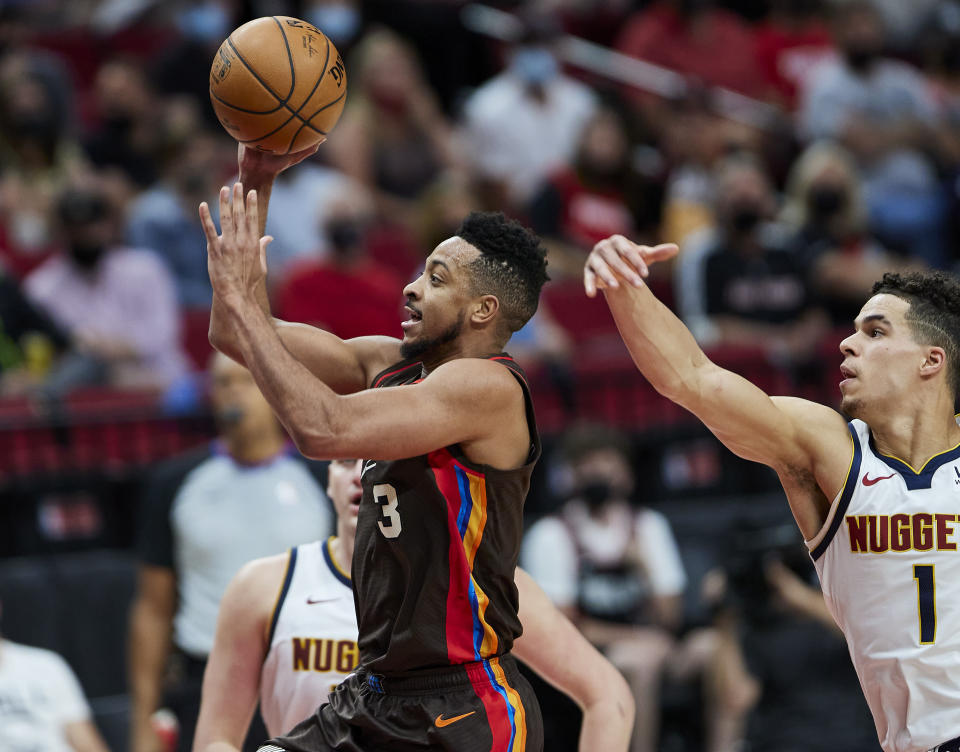 Portland Trail Blazers guard CJ McCollum shoots in front of Denver Nuggets forward Michael Porter Jr. during the second half of Game 6 of an NBA basketball first-round playoff series Thursday, June 3, 2021, in Portland, Ore. (AP Photo/Craig Mitchelldyer)