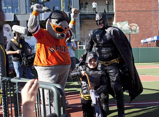 SAN FRANCISCO, CA - NOVEMBER 15: Leukemia survivor Miles, 5, dressed as BatKid, and Batman release San Francisco Giants mascot Lou Seal from the Penguin as part of a Make-A-Wish foundation fulfillment at AT&T Park November 15, 2013 in San Francisco. The Make-A-Wish Greater Bay Area foundation turned the city into Gotham City for Miles by creating a day-long event bringing his wish to be BatKid to life. (Photo by Ramin Talaie/Getty Images)