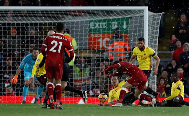 "Soccer Football - Premier League - Liverpool vs Watford - Anfield, Liverpool, Britain - March 17, 2018 Liverpool's Mohamed Salah scores their fourth goal and completes his hat-trick Action Images via Reuters/Lee Smith EDITORIAL USE ONLY. No use with unauthorized audio, video, data, fixture lists, club/league logos or ""live"" services. Online in-match use limited to 75 images, no video emulation. No use in betting, games or single club/league/player publications. Please contact your account representative for further details."