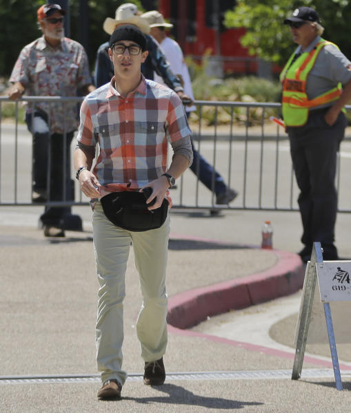 San Francisco Giants pitcher Tim Lincecum arrives at Petco Park where on Saturday he threw a no-hitter against the San Diego Padres in a baseball game in San Diego, Sunday, July 14, 2013. (AP Photo/Lenny Ignelzi)