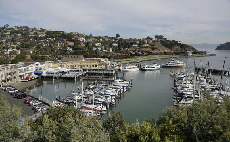 In this photo taken Thursday, Nov. 5, 2015, a couple of ferries at top right pull into Tiburon, Calif. Whether you're on a business trip or any other kind of visit to San Francisco, with a few hours to spare, you can take the ferry across the bay to Tiburon, have a meal, poke through the galleries and shops of Main Street, and sit back and enjoy the view. (AP Photo/Eric Risberg)
