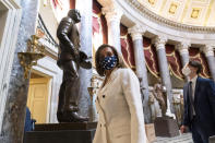 House Speaker Nancy Pelosi of Calif., walks through Statuary Hall, during the vote on the Democrat's $1.9 trillion COVID-19 relief bill, on Capitol Hill, Wednesday, March 10, 2021, in Washington. (AP Photo/Alex Brandon)